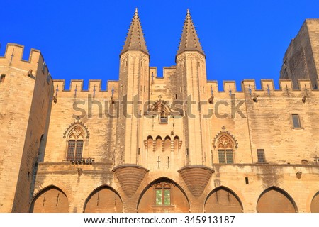 Large Gothic building of the Papal Palace (Palais des Papes) in Avignon, Provence, France - stock photo