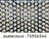 large group of bobbin thread cones on a warping machine in a textile mill. - stock photo