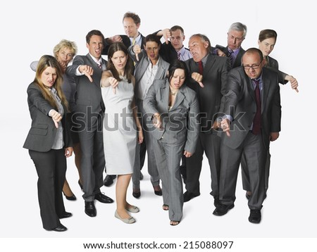 Large group of businesspeople showing thumbs down on white background - stock photo