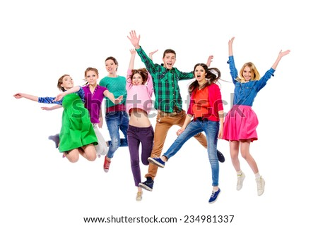 Large group of cheerful young people jumping for joy. Isolated over white. - stock photo
