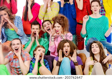Large group of cheerful young people shouting something. Isolated over white. - stock photo