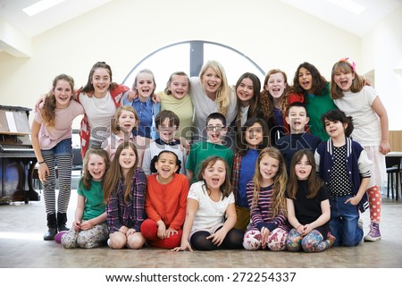 Large Group Of Children With Teacher Enjoying Drama Workshop Together - stock photo
