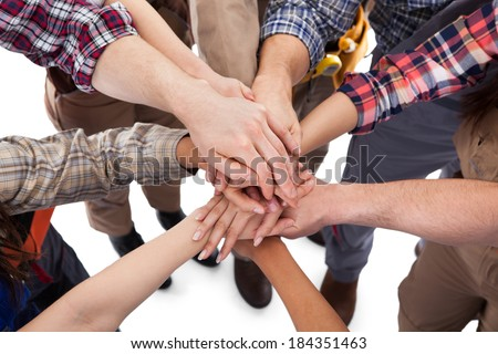 Large group of construction worker stacking hands. Isolated on white - stock photo