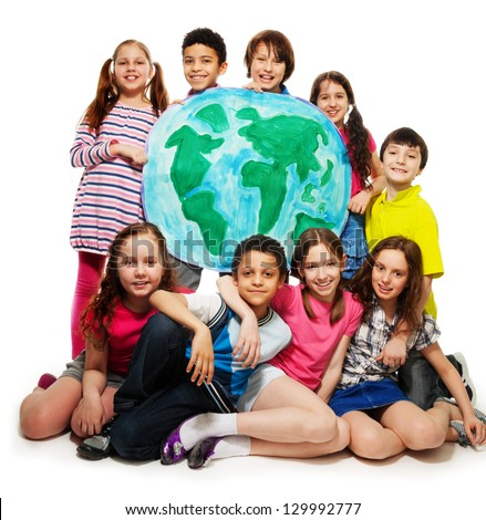 Large group of diversity looking teen kids, boys and girls holding globe map - stock photo