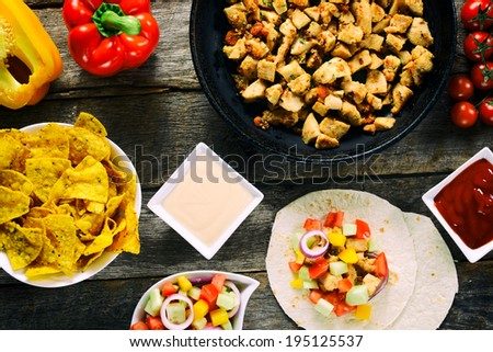 Large group of food from above on the wooden background  - stock photo
