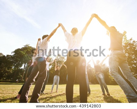 large group of friends together in a park having fun - stock photo