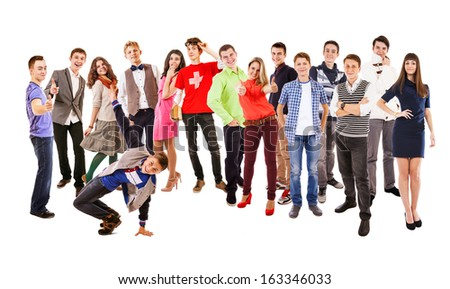 Large group of happy multicolored dressed teenagers on the white - stock photo