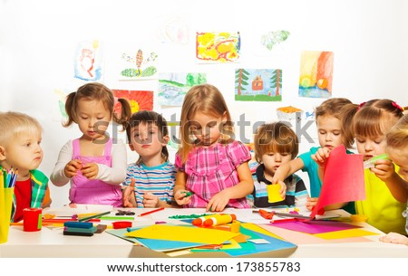 Large group of kids of little boys and girls  on the art lesson class - stock photo
