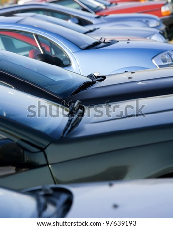 Large group of Parked Cars in a row - stock photo