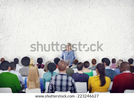 Large Group of People Listening to the Speaker - stock photo