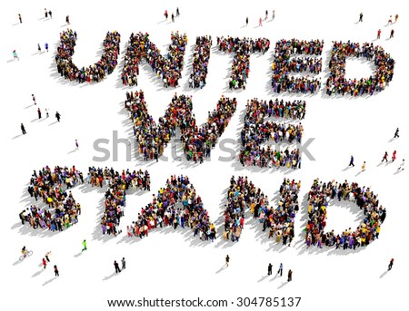 """Large group of people seen from above gathered in the shape of the text """"UNITED WE STAND"""" - stock photo"""
