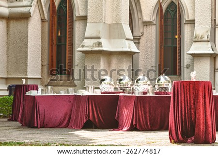 Large group of red tables for a formal event. - stock photo