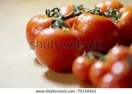 Large group of red tomatoes on domestic kitchen table. Horizontal shape, copy space - stock photo