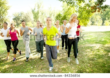 large group of young people running in park - stock photo