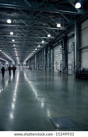 Large hall with people silhouettes, modern architecture. - stock photo