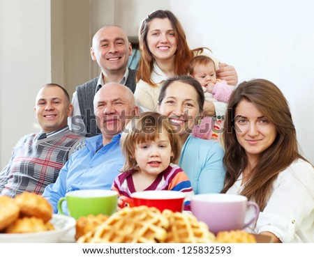large happy family having tea and baked at home - stock photo