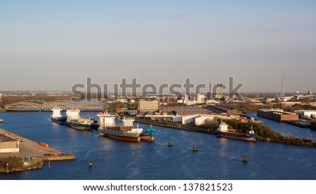 Large harbor of Hamburg, Germany with big container ships - stock photo
