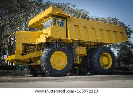Large haul truck ready for big job in a mine. Low saturation and - stock photo