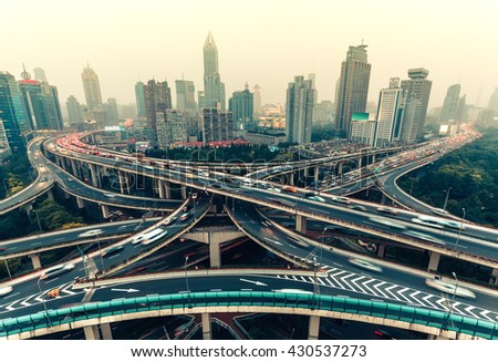 Large highway junction in Shanghai, China with traffic. Famous landmark of Shanghai in the evening. - stock photo