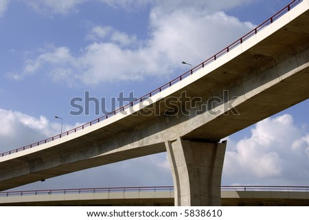 Large highway viaducts perspective against the sky - stock photo