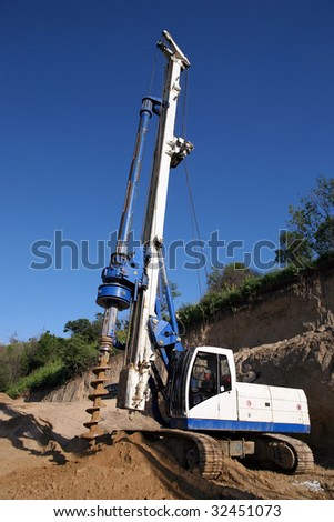 Large hole digger on a construction site. - stock photo
