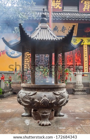 Large incense urn in front of the Jade Buddha Temple, Shanghai, China - stock photo