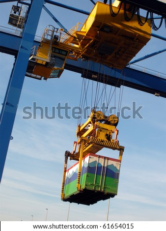 Large industrial crane for cargo containers in port - stock photo