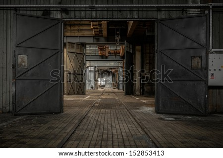 Large industrial door in a factory - stock photo