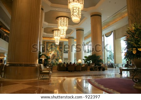 Large interior with high ceiling and posh chandeliers - stock photo