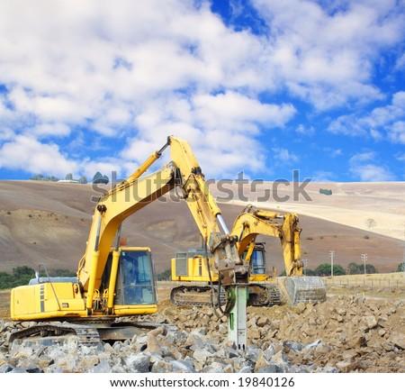 Large jackhammer smashing rocks - stock photo