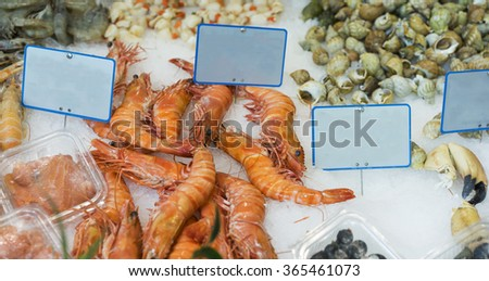 Large king prawns and other seafood popular food for easter and christmas for sale at fish markets - stock photo