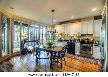 large kitchen with big view windows - stock photo