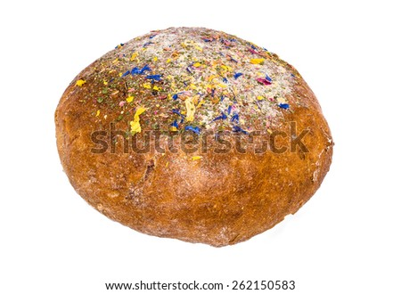 Large loaf of bread deliciously decorated with dried flowers isolated on white - stock photo