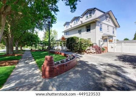 Large luxury beige craftsman classic American house exterior. - stock photo
