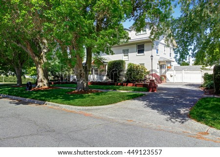 Large luxury beige craftsman classic American house exterior. View from the road - stock photo