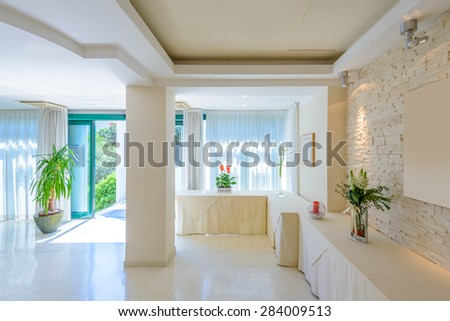 Large luxury dining room interior. New empty hotel or home space. - stock photo