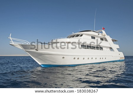 Large luxury private motor yacht out on a tropical sea - stock photo