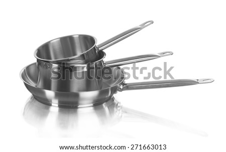 Large metal frying pans set, image is taken over a white background - stock photo