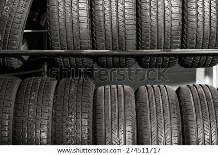 Large Metal Tires Rack. Modern Car Tire Service and Sale. - stock photo