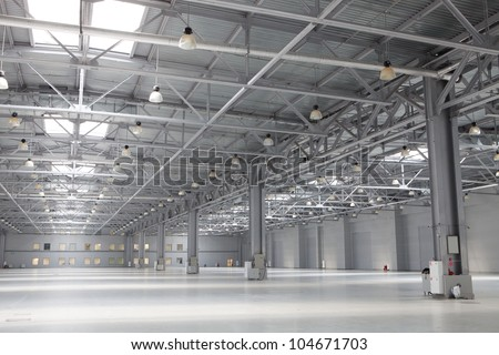 Large modern empty storehouse - stock photo