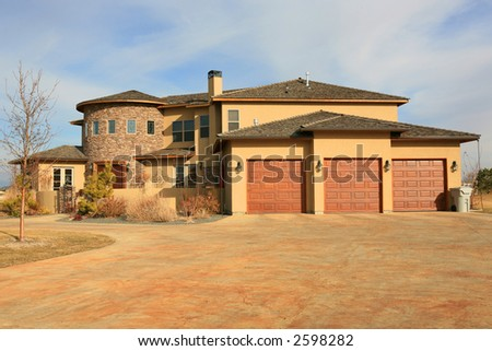 Large modern three story house with three car garage - stock photo