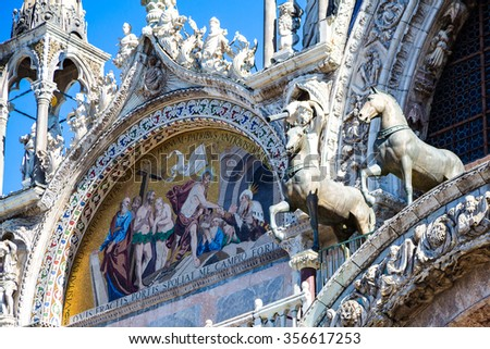 Large mosaic of the Basilica of San Marco in Venice with statues of horses. - stock photo