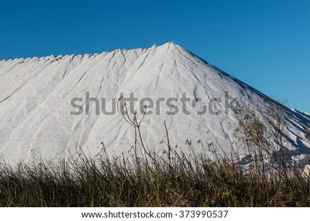 Large mountain of salt in it's natural state being produced in Chula Vista, California.  - stock photo