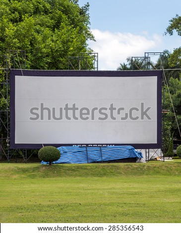 Large movie screen in the meadow of Thai village. - stock photo