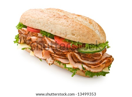 Large multi-grain turkey submarine sandwich with lettuce, tomatoes and cheese - stock photo