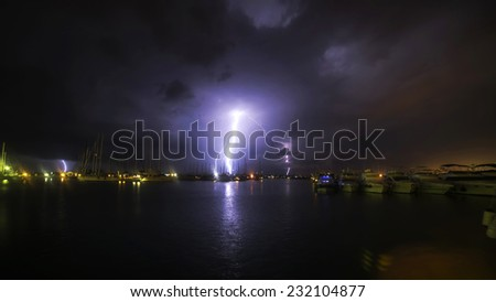 Large night thunderstorm and lightning in the port Sukosan, Croatia - stock photo