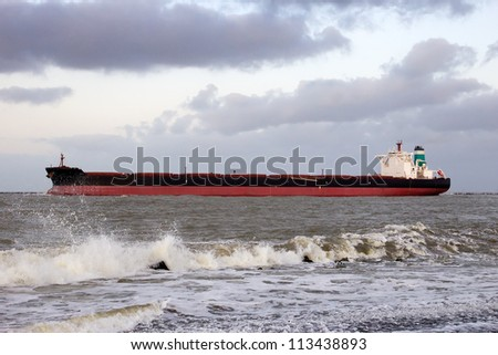 Large oil tanker leaving the port of Rotterdam, The Netherlands - stock photo