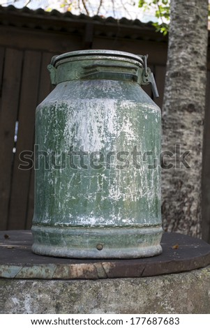 Large old metal milk can - stock photo