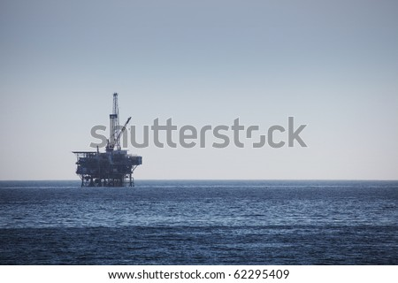 Large Pacific Ocean oil rig drilling platform - stock photo