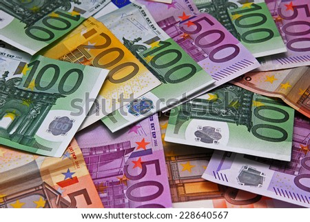 Large paper money euro on a flat surface - stock photo